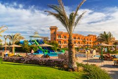 Tropical resort Three Corners Sunny Beach hotel. HURGHADA, EGYPT - APR 9, 2013: Tropical resort Three Corners Sunny Beach in Hurghada on 12 April 2013. Three Stock Photo