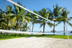 Tropical resort with volleyball court Royalty Free Stock Image