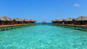 Tropical resort with water bungalows in Maldives. Luxury resort with water bungalows in Maldives royalty free stock image