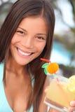 Tropical resort woman. Vacation woman enjoying drink in tropical resort. Gorgeous multiracial Asian / Caucasian woman young woman in bikini during summer Stock Photography