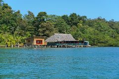 Tropical restaurant and cabin over water in Panama Stock Photography