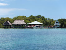 Tropical restaurant over the water Royalty Free Stock Photography