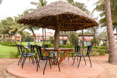 Tropical restaurant with straw sunshade umbrella Stock Photo
