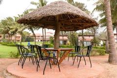 Tropical restaurant with straw sunshade umbrella Stock Photo