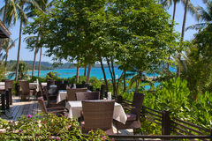 Tropical restaurant. Table and chairs with a beautiful sea view on island Koh Kood, Thailand Stock Image