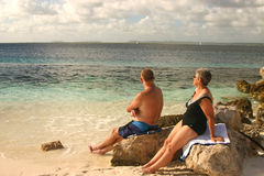 Tropical retirement. Retired couple on tropical beach stock images