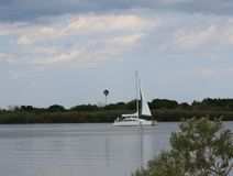 Tropical River, Blue Sky and Sailboat stock photo