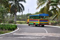 Tropical road and bus in Dominican Republic Royalty Free Stock Images