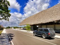 Tropical road and car in Dominican Republic Royalty Free Stock Photography