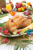 Tropical Roasted Turkey. Garnished roasted turkey with tropical fruits, flowers, and refreshing cocktails royalty free stock photos