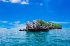 Tropical rock island against blue sky and  sea Royalty Free Stock Photography