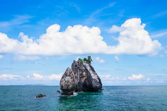 Tropical rock islands, for diving against blue sky Stock Photo