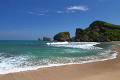 Tropical Rocky Beach. Siung Beach, a famous rocky beach in Jogjakarta Stock Image