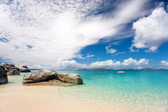 Tropical rocky island beach. Beautiful tropical rocky island beach background seascape in caribbean waters Stock Images