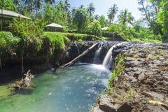 Tropical Samoa. Exotic waterfall on the island of Upolu in Samoa Royalty Free Stock Photography