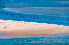 Tropical sand beach with turquoise water and blue sky Royalty Free Stock Image