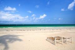 Tropical sand beach Stock Photos