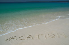 Tropical Sandy Beach With. Vacation Inscription on Sand. Angle View royalty free stock photos