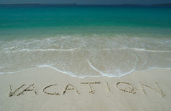 Tropical Sandy Beach With. Vacation Inscription on Sand. Straight View stock photo