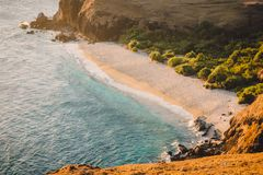 Tropical sandy beach and blue ocean at sunset in Indonesia stock photos