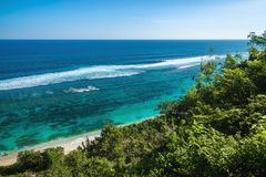 Tropical sandy beach and clear ocean with blue water in Bali royalty free stock images