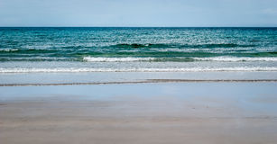 Tropical sandy beach with clear sky. Royalty Free Stock Images