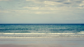 Tropical sandy beach with clear sky. Royalty Free Stock Photo