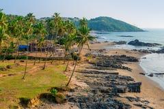 Tropical sandy beach and palm trees Stock Photos
