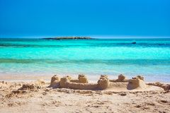 Tropical sandy beach with sandcastles and turquoise water, in Elafonisi, Crete stock photography