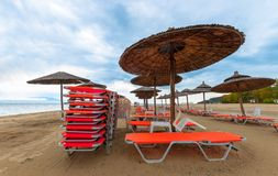Tropical scene st the beach. Tropical scene with Parasol and beach beds Royalty Free Stock Photos