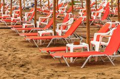 Tropical scene st the beach. Tropical scene with Parasol and beach beds Stock Photography