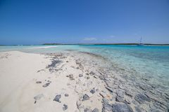 Sandy Beach with Charter Catamarans Anchored royalty free stock photography