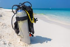 Maldives island beach, scuba diving gear on a beach. Tropical scene with scuba dive gear on white sand near the sea royalty free stock image