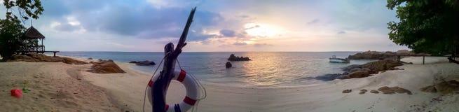 Tropical scene on seashore. With panoramic image Stock Image