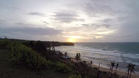 Tropical scene Sunset slow motion on a Balangan beach, Bali island, Indonesia. View from the cliff. stock footage