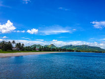 Tropical scenery with blue waters and sky royalty free stock photos