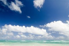Tropical sea. Carribean sea and white fluffy clouds Royalty Free Stock Photography