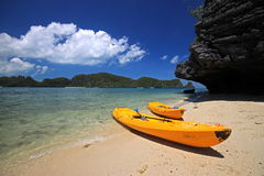Tropical sea. Two yellow kayak on the beach with the tropical sea in background Royalty Free Stock Images