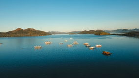Tropical sea bay with boats. Aerial view: Seascape Busuanga, Palawan, Philippines. stock video