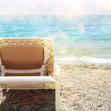 Tropical sea beach and chaise lounger. Summer travel and vacation concept. Photo of tropical sea beach and chaise lounger. Summer travel and vacation concept stock photo