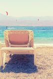 Tropical sea beach and chaise lounger. Summer travel and vacation concept. Photo of tropical sea beach and chaise lounger. Summer travel and vacation concept stock image