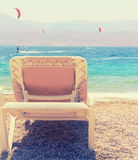 Tropical sea beach and chaise lounger. Summer travel and vacation concept. Photo of tropical sea beach and chaise lounger. Summer travel and vacation concept stock images