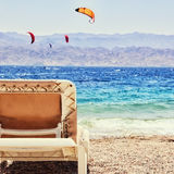 Tropical sea beach and chaise lounger. Summer travel and vacation concept. Photo of tropical sea beach and chaise lounger. Summer travel and vacation concept royalty free stock images