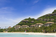 Tropical sea, beach and hotel on sky background. Tropical sea, beach and hotel on blue sky background Royalty Free Stock Photos