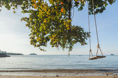 Tropical sea beach with swing tied Royalty Free Stock Photography