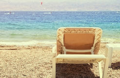 Tropical sea beach and two chaise lounger at sunset. Tropical sea beach and two chaise lounger at sunset stock photos