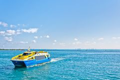 Tropical sea, ferry and Cancun skyline Stock Images