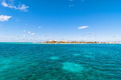 Tropical sea and Isla Mujeres coastline, Mexico. Tropical sea and Isla Mujeres coastline view from sea in Cancun, Mexico Royalty Free Stock Photography