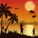People with Kites on tropical beach Stock Photography