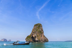 Tropical sea with limestone rock and longtail boat at railay beach  krabi Thailand Royalty Free Stock Photos